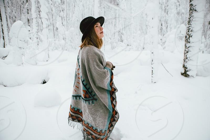 Folk girl in winter forest photo