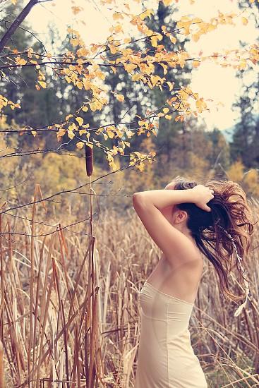 woman girl dark brown hair long hair reeds tall grass boudoir neutral natural photo