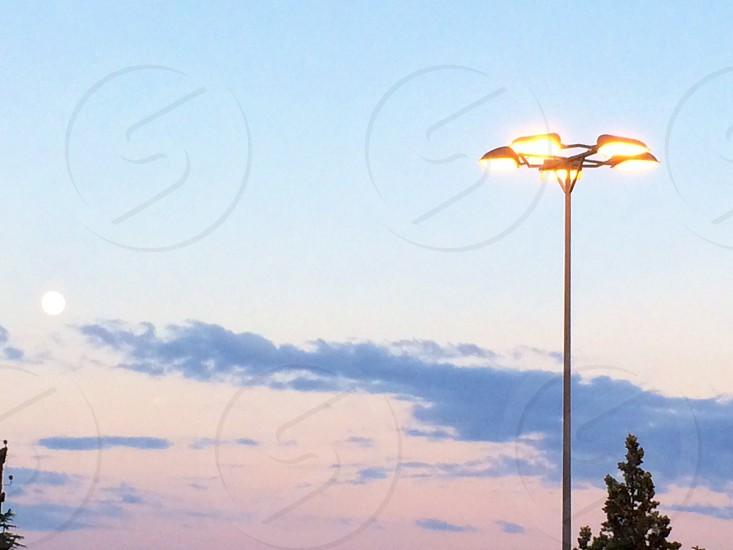 Natural moon light vs human produced light photo