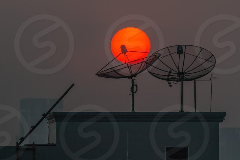 Round sun and satellite dishes. photo