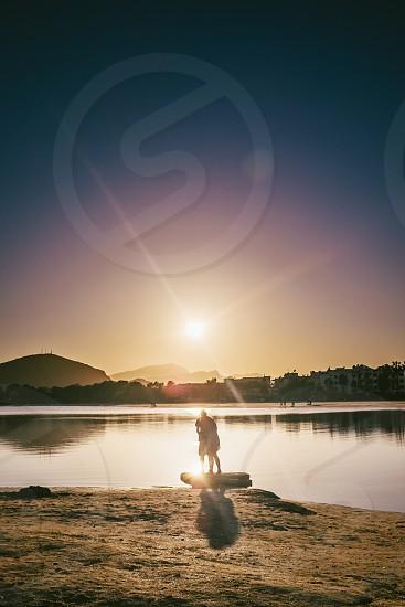 couple beside lake photo