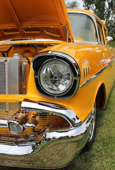 yellow classic car with hood opened photo