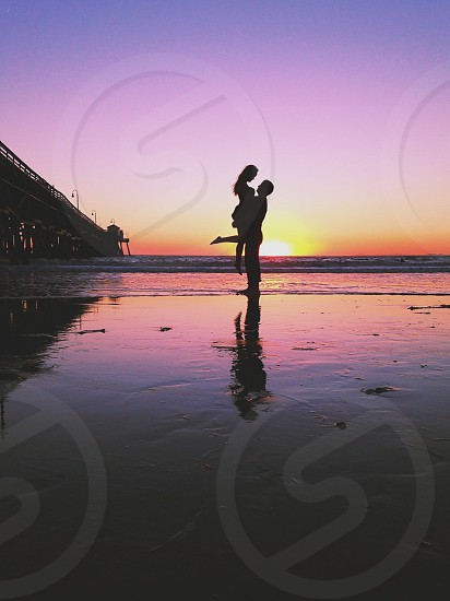 couple silhouette in sunset view photo