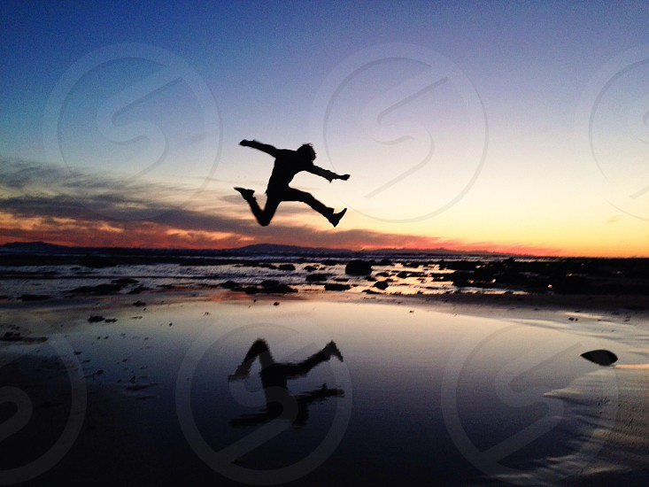 jumping man silhouette photo