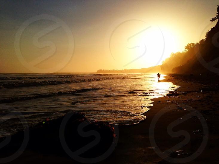 yellow sun rays and sea shore photo