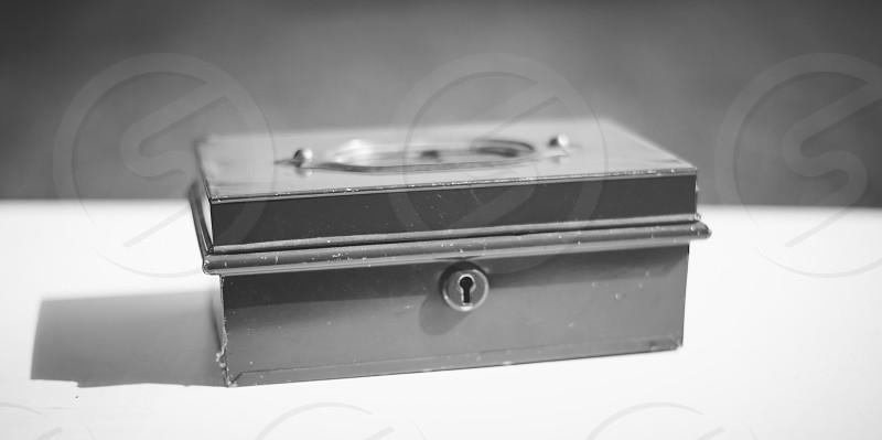 black and white image of rectangle box with keyhole photo