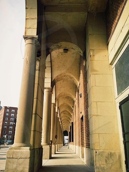 white concrete column beside building wall photo