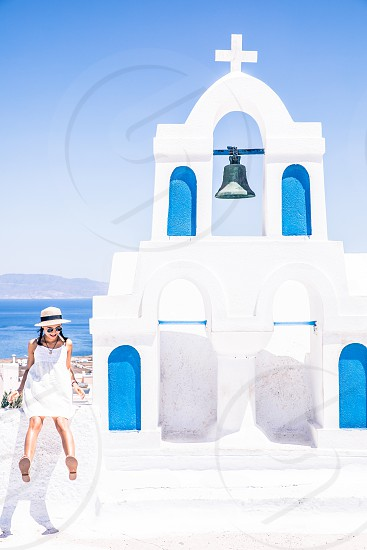 Young Tourist Woman On Vacation In Famous Greek Island Santorini photo