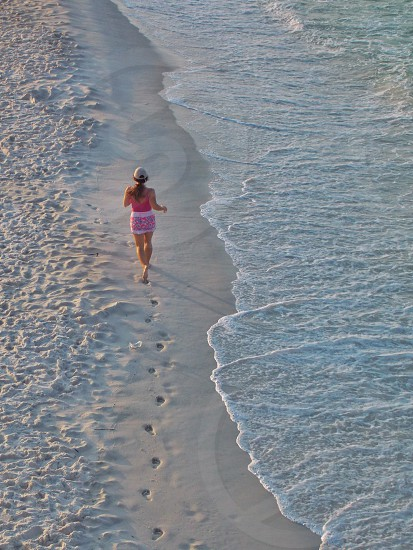 woman on seashore running photo