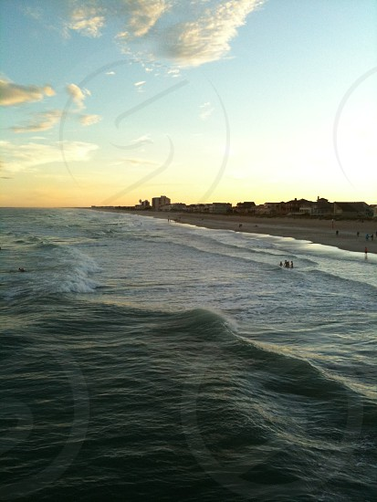 Surf at sunset photo