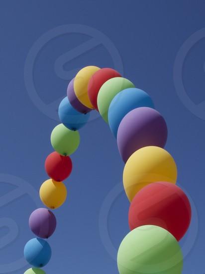 minimal blue sky rainbow balloons        photo
