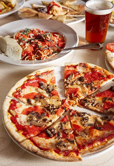 Pepperoni Pizza and other dishes photo