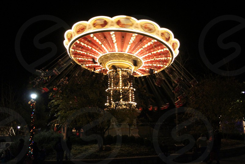 Fair or festival swing lit up in the dark photo