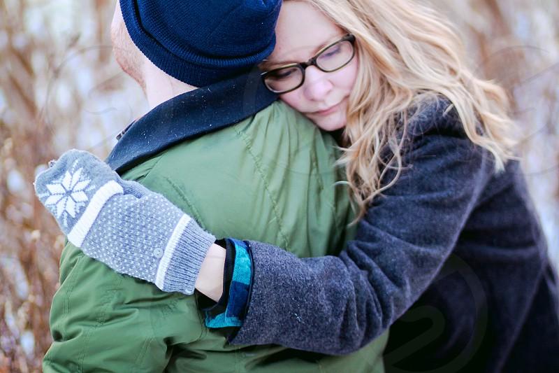 woman hugging man photo