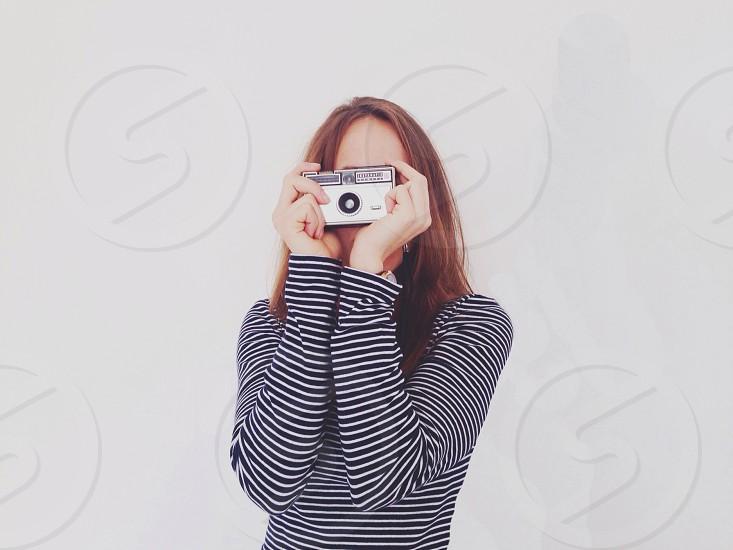 women's black and white long sleeved shirt  photo