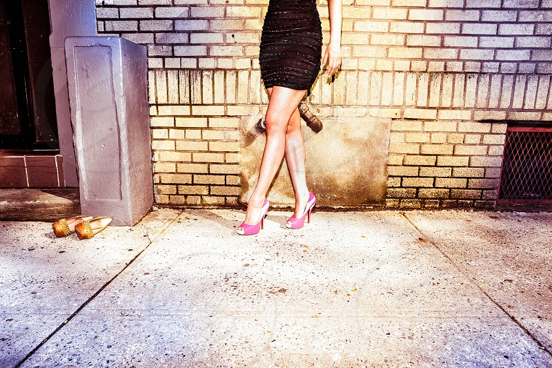 legs model black dress sequence pink shoes brick wall photo