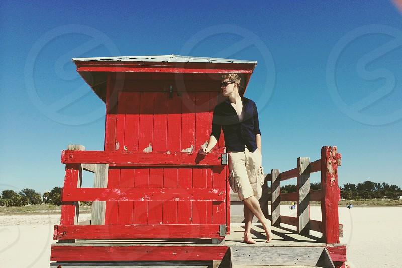 man wearing brown cargo shorts standing photo