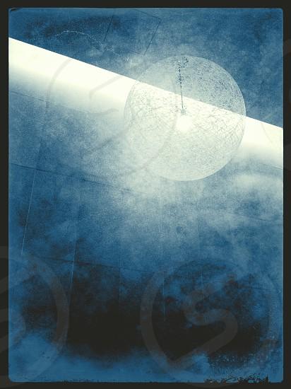 A globe lighting fixture photo