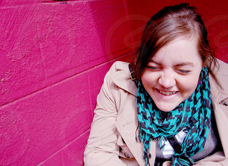 happy girl against a pink wall in NYC photo