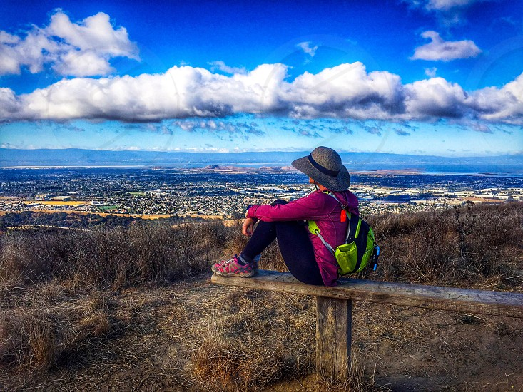 Portrait behind hiker cloudsadmiring awe hydration bag hat woman  photo