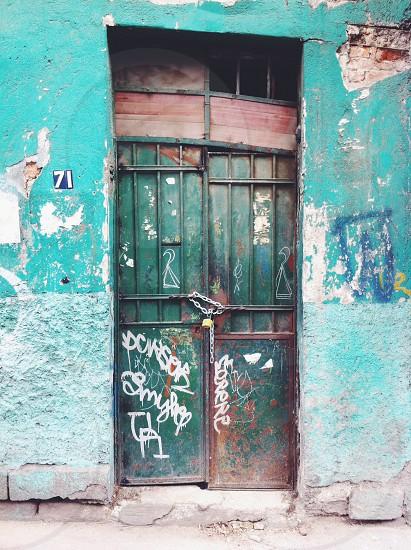 closed green metal gate photo