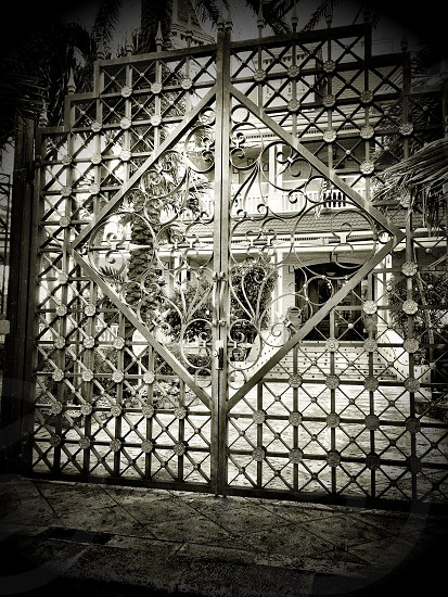 metal entry gate with diamond and square design photo