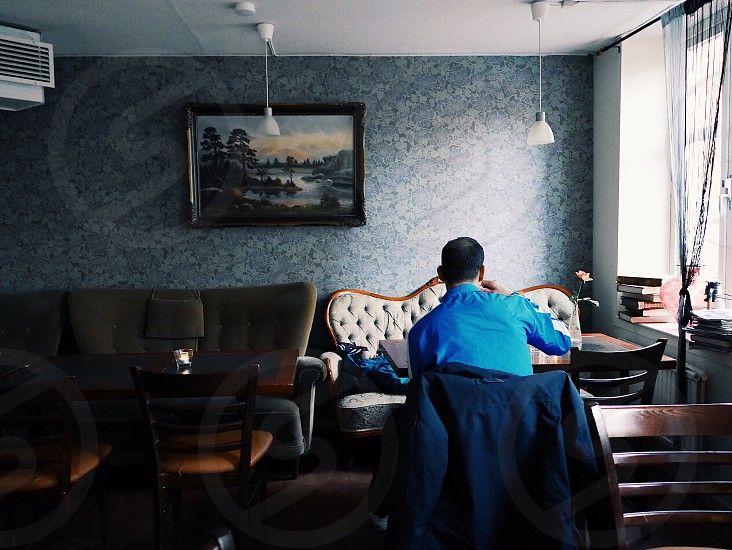 At the cafe cafe unrecognizable person drinking coffee room vintage  afternoon coffee photo