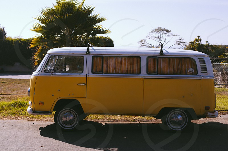 yellow and white volkswagen retro kombi bus parked on roadside during daytime photo