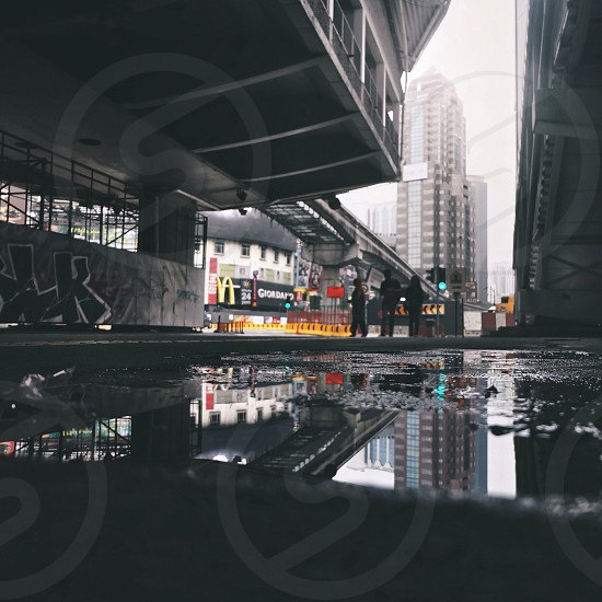 Puddle play during rainy day in the middle of Kuala Lumpur city photo