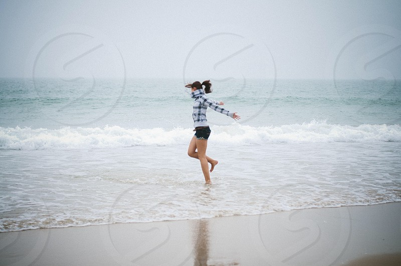 frolicking in beach water photo