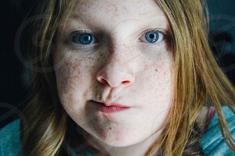 unsure emotion blue eyes freckles girl beauty photo