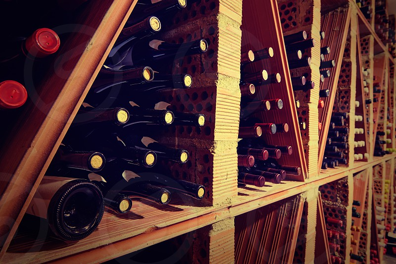 Wine Cellar from Mediterranean with bottles stacked in rows photo