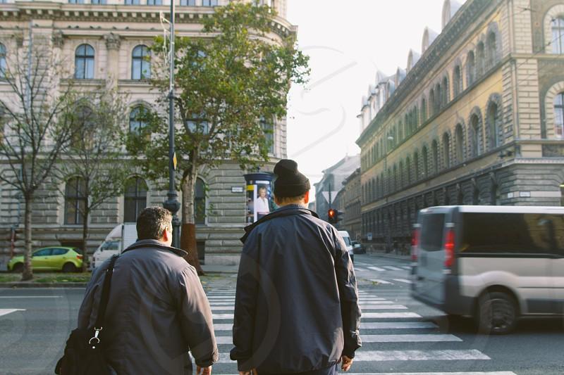 2 person crossing pedestrian photo
