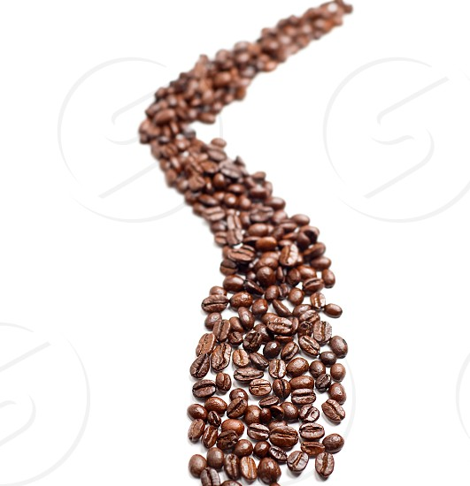 bounch of roasted coffee beans mimic a road shape photo
