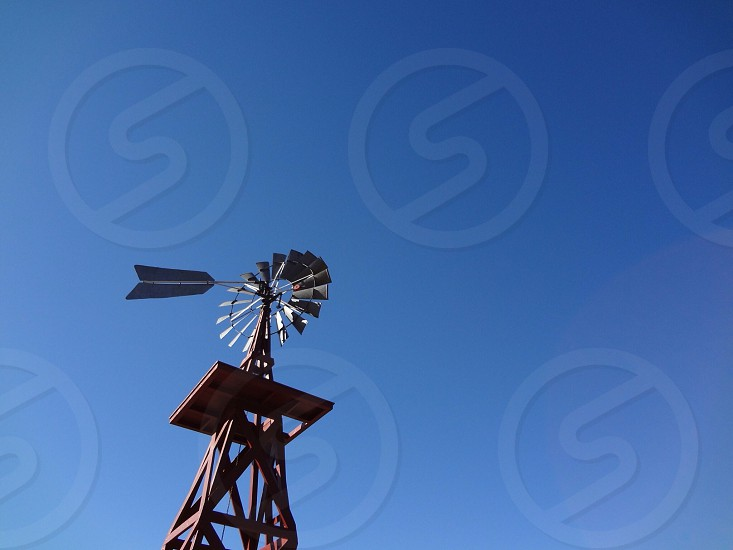 Windmill blue sky photo