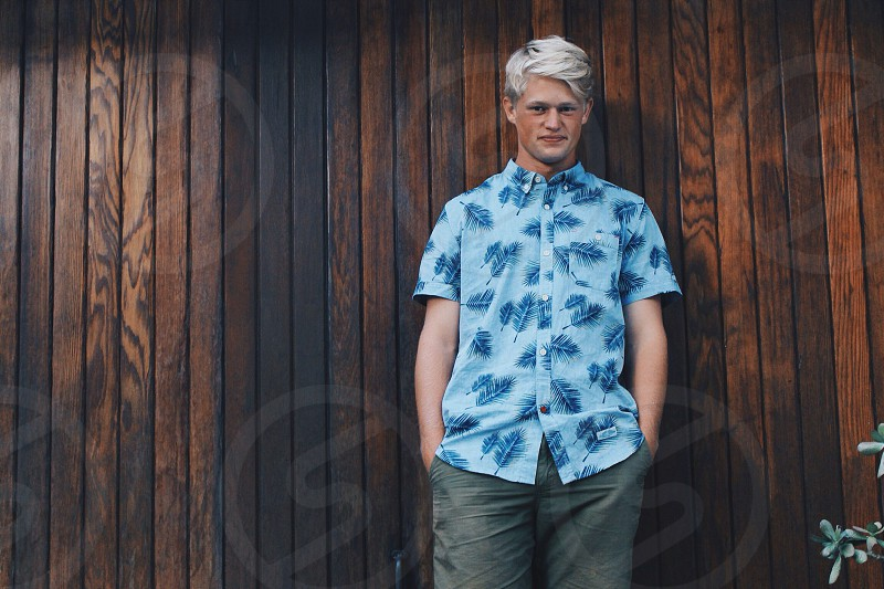 man in blue palm frond print short sleeved button down shirt photo