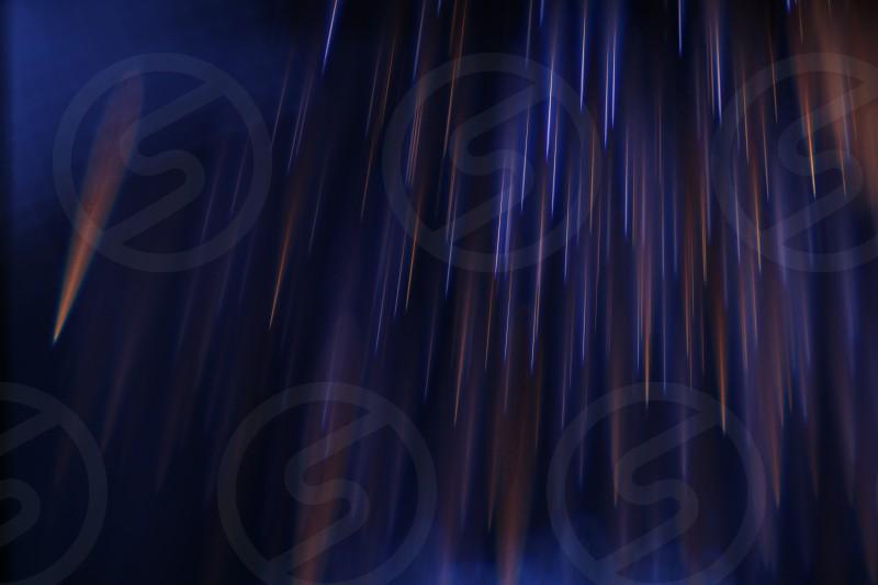 Fireworks light painting light bending experimental optics gentle rain of light sparkles abstract photography.  photo