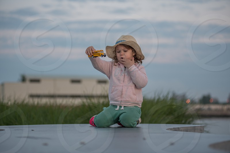 Child girl playing toy photo