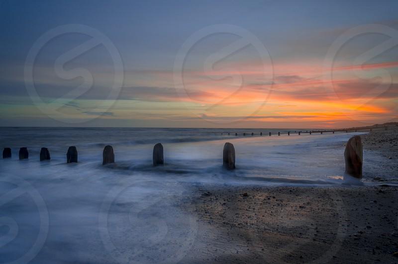 Sea sunset waves colours peaceful beach seaside calm evening still photo