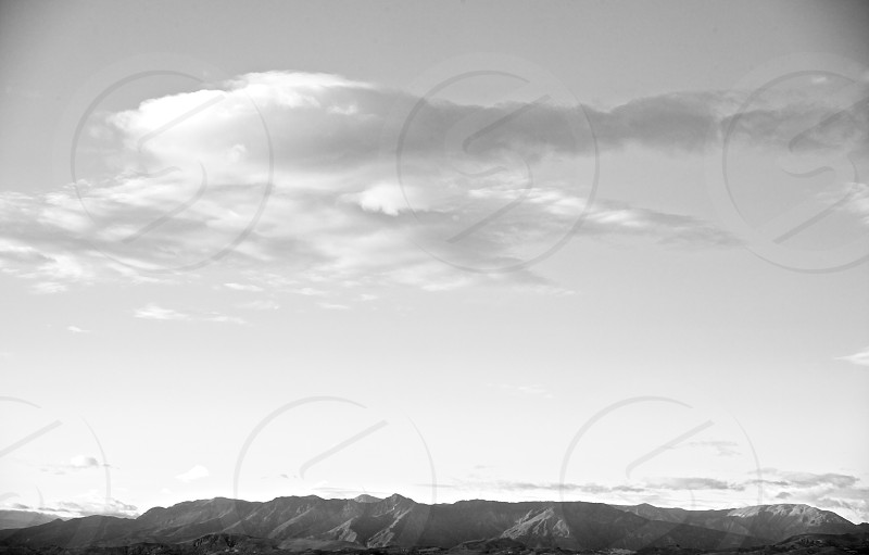 white clouds above mountains photo