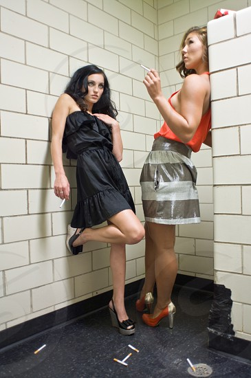 rebel smoking bathroom fashion clothing models cigarette risky trouble  photo