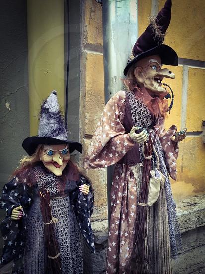 Outdoor outside exterior portrait vertical Tallinn Estonia Europe European display shop witches witch mannequin mannequins  photo