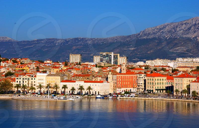 Split  Croatiabody · building · croatia · edifice · sunny· lights · sun blue sky · material · mountain · orange · split · structure · visible light · water photo