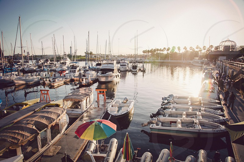 A sunset at a boat harbor in Long Beach California.  photo