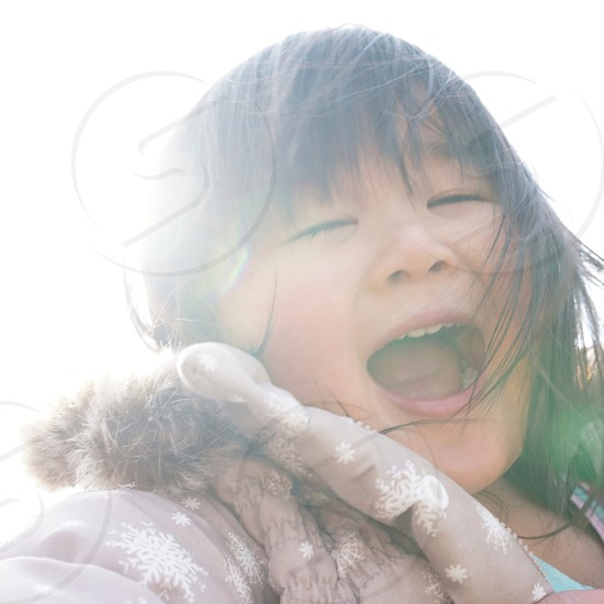 girl in brown bubble jacket smiling photo