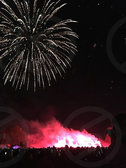 Fireworks bonfire New Years glow vibrant red sparkle love family celebration group together photo