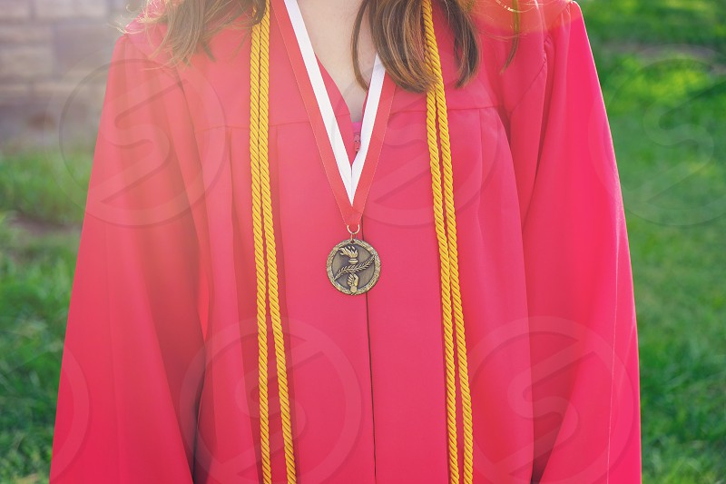 Red graduation gown with honors  photo