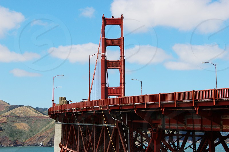 red bridge on body of water during daytime photo