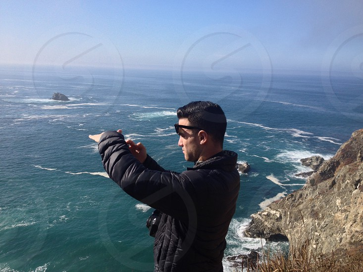 man in black bubble jacket taking a photo photo
