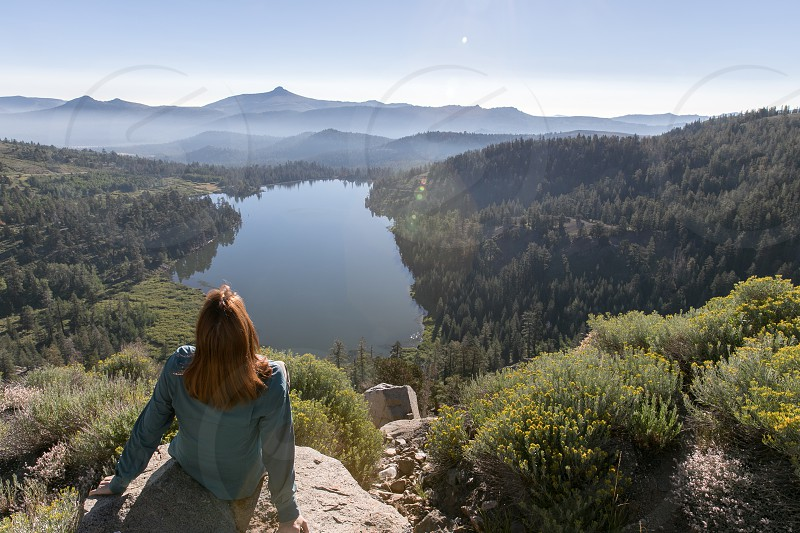 A woman enjoys the view over Red Lake at Carson Pass in the Sierra Nevada Mountains of California.  Model released photo